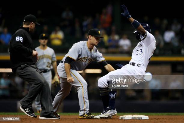 Max Moroff of the Pittsburgh Pirates tags out Keon Broxton of the Milwaukee Brewers at second base in the sixth inning at Miller Park on September 13...