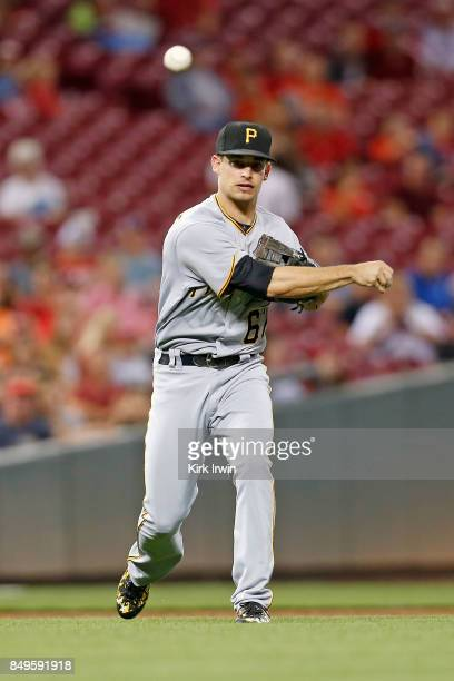 Max Moroff of the Pittsburgh Pirates throws the ball to first base during the game against the Cincinnati Reds at Great American Ball Park on...