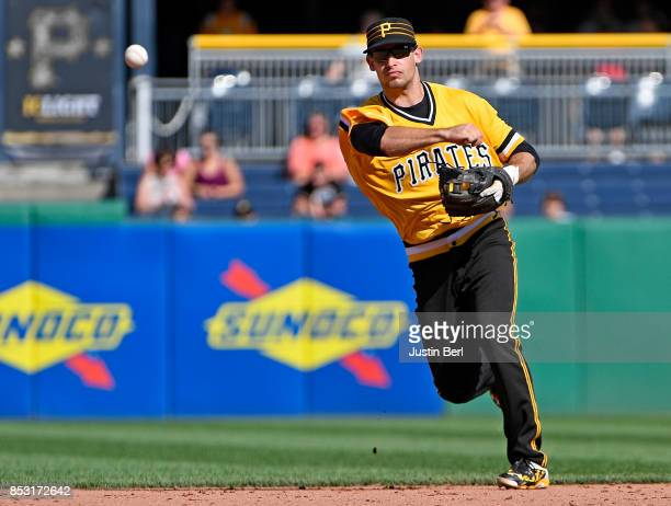 Max Moroff of the Pittsburgh Pirates throws to first base to force out Kolten Wong of the St Louis Cardinals in the sixth inning during the game at...