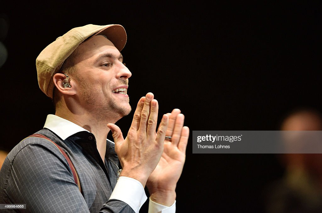Max Mutzke reacts at the end of the anniversary concert Rilke Projekt Live 'Dir zur Feier' at Alte Oper on December 4, 2015 in Frankfurt am Main, Germany. The anniversary concert was held on the occasion of the 140th birthday of Rainer Maria Rilke (1875 - 1926).