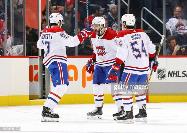 Max Pacioretty Alex Galchenyuk and Charles Hudon of the Montreal Canadiens celebrate an overtime goal against the Winnipeg Jets at the Bell MTS Place...