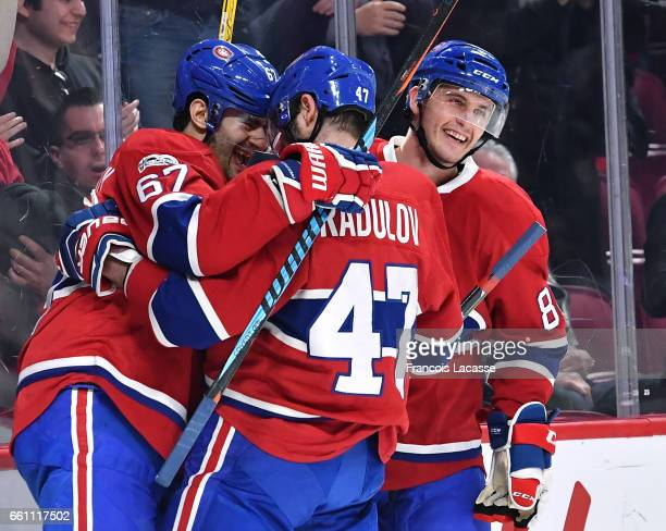 Max Pacioretty and Alexander Radulov of the Montreal Canadiens celebrate a goal against the Florida Panthers in the NHL game at the Bell Centre on...