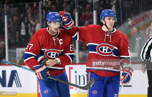 Max Pacioretty and Alexei Emelin of the Montreal Canadiens celebrate a goal against the New York Islanders in the NHL game at the Bell Centre on...