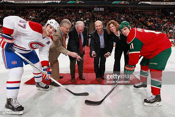 Max Pacioretty of the Montreal Canadiens along with Zach Parise of the Minnesota Wild take part in the honorary puck drop with 2014 US Hockey Hall of...