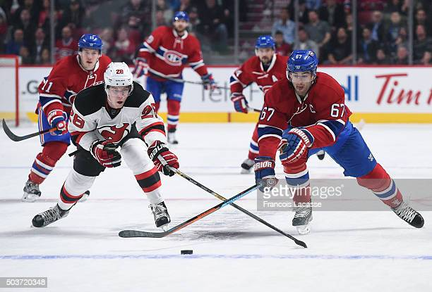 Max Pacioretty of the Montreal Canadiens and Damon Severson of the New Jersey Devils skate for the puckin the NHL game at the Bell Centre on January...