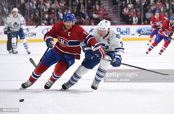 Max Pacioretty of the Montreal Canadiens and Dion Phaneuf of the Toronto Maple Leafs battle for puck in the NHL game at the Bell Centre on October 24...