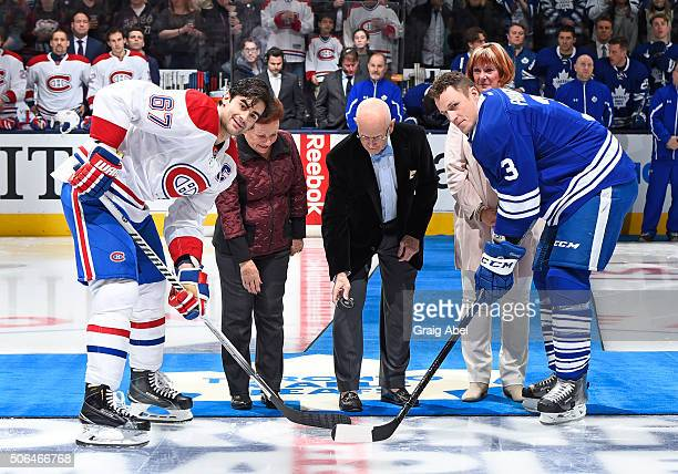 Max Pacioretty of the Montreal Canadiens and Dion Phaneuf of the Toronto Maple Leafs take part in an on ice ceremony with Barb Tushingham Dave Keon...