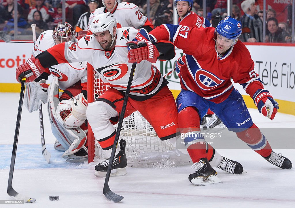 <a gi-track='captionPersonalityLinkClicked' href=/galleries/search?phrase=Max+Pacioretty&family=editorial&specificpeople=4324972 ng-click='$event.stopPropagation()'>Max Pacioretty</a> #67 of the Montreal Canadiens and Jay Harrison #44 of the Carolina Hurricanes battle for the puck during the NHL game on April 1, 2013 at the Bell Centre in Montreal, Quebec, Canada.