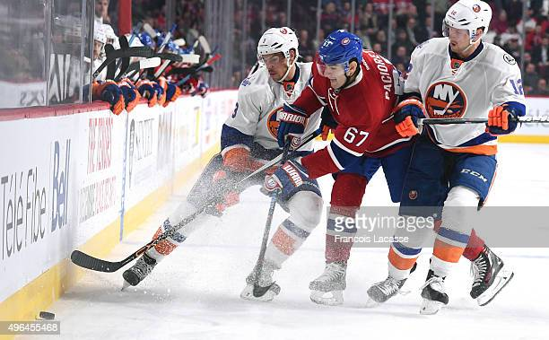 Max Pacioretty of the Montreal Canadiens and John Tavares of the New York Islanders fight for the puck in the NHL game at the Bell Centre on November...