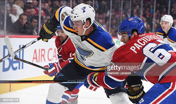 Max Pacioretty of the Montreal Canadiens and Jori Lehtera of the StLouis Blues battle for the puck in the NHL game at the Bell Centre on October 20...