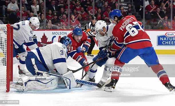 Max Pacioretty of the Montreal Canadiens battle for the puck against JT Brown of the Tampa Bay Lightning in Game Five of the Eastern Conference...
