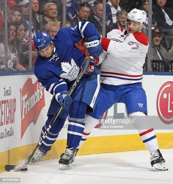 Max Pacioretty of the Montreal Canadiens battles against Alexey Marchenko of the Toronto Maple Leafs during an NHL game at the Air Canada Centre on...