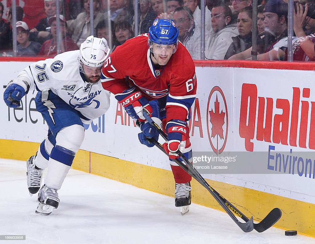 <a gi-track='captionPersonalityLinkClicked' href=/galleries/search?phrase=Max+Pacioretty&family=editorial&specificpeople=4324972 ng-click='$event.stopPropagation()'>Max Pacioretty</a> #67 of the Montreal Canadiens battles for the puck against <a gi-track='captionPersonalityLinkClicked' href=/galleries/search?phrase=Radko+Gudas&family=editorial&specificpeople=5648763 ng-click='$event.stopPropagation()'>Radko Gudas</a> #75 of the Tampa Bay Lightning in NHL action on April 18, 2013 at the Bell Centre in Montreal, Quebec, Canada.