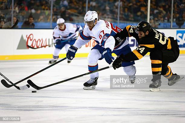 Max Pacioretty of the Montreal Canadiens battles with Adam McQuaid of the Boston Bruins during the 2016 Bridgestone NHL Classic at Gillette Stadium...