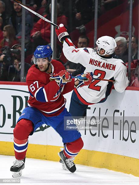 Max Pacioretty of the Montreal Canadiens body checks Matt Niskanen of the Washington Capitals in the NHL game at the Bell Centre on December 3 2015...