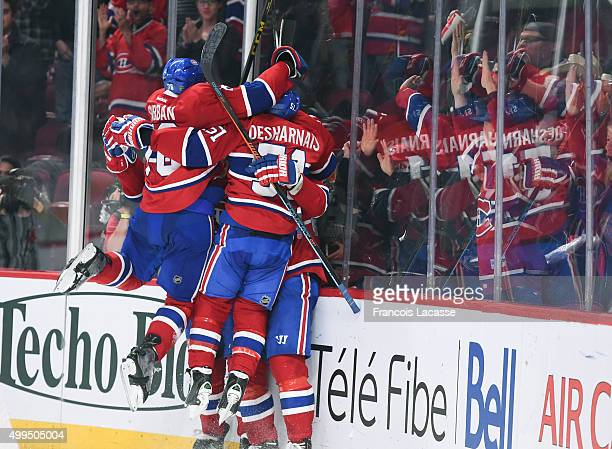 Max Pacioretty of the Montreal Canadiens celebrate after scoring a goal and celebrate defeating the Columbus Blue Jackets in the NHL game at the Bell...