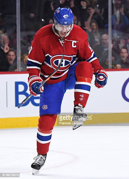 Max Pacioretty of the Montreal Canadiens celebrate after scoring a goal against the Tampa Bay Lightning in the NHL game at the Bell Centre on October...