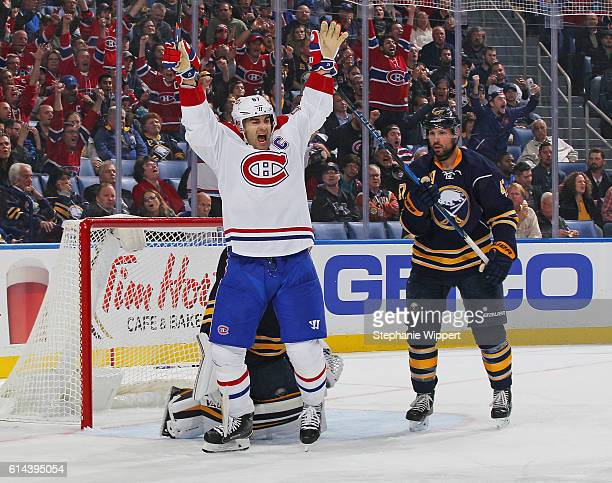 Max Pacioretty of the Montreal Canadiens celebrates a third period goal by teammate Brendan Gallagher alongside Zach Bogosian of the Buffalo Sabres...