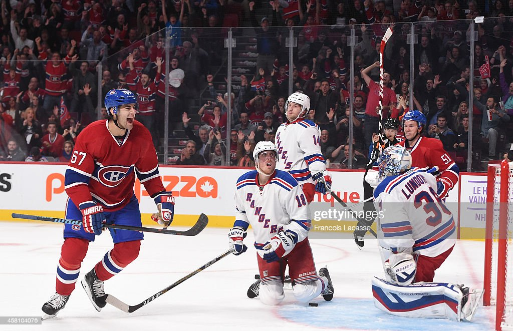 Max Pacioretty of the Montreal Canadiens celebrates after scoring a goal against of the New York Rangers in the NHL game at the Bell Centre on...