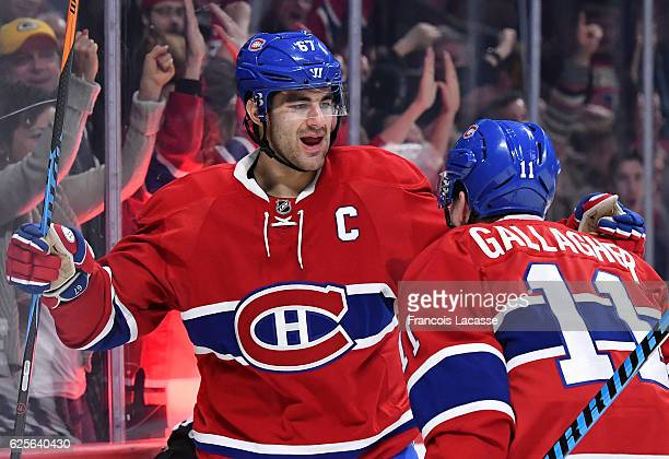 Max Pacioretty of the Montreal Canadiens celebrates after scoring a goal against the Carolina Hurricanes in the NHL game at the Bell Centre on...