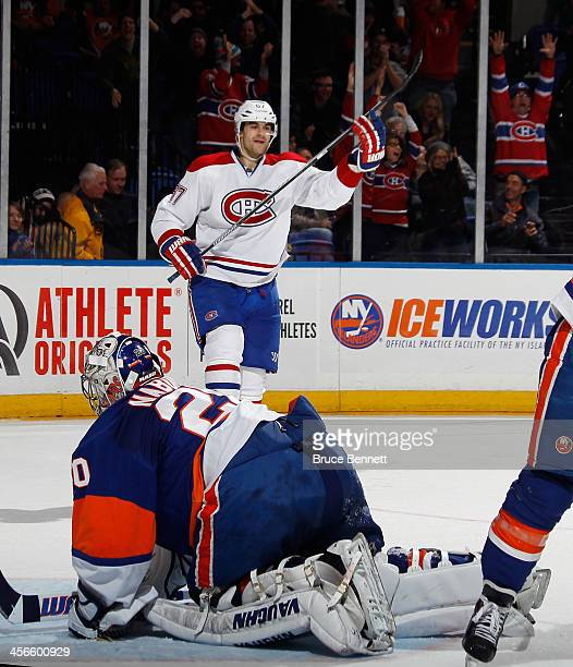 Max Pacioretty of the Montreal Canadiens celebrates his game winning goal at 151 of overtime against Evgeni Nabokov of the New York Islanders at the...