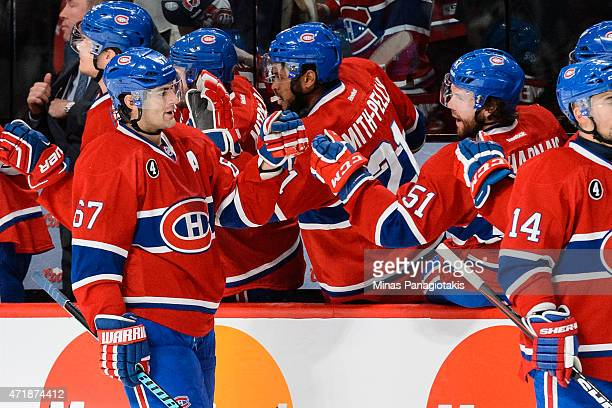Max Pacioretty of the Montreal Canadiens celebrates his goal with teammates on the bench in Game One of the Eastern Conference Semifinals against the...