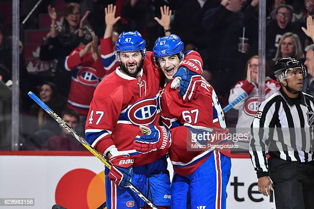 Max Pacioretty of the Montreal Canadiens celebrates his hattrick goal with teammate Alexander Radulov during the NHL game against the Colorado...