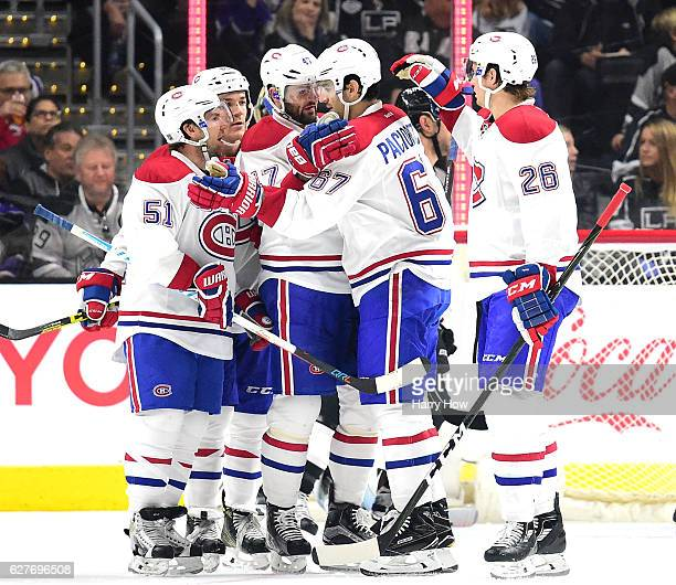 Max Pacioretty of the Montreal Canadiens celebrates his power play goal with Alexander Radulov Andrew Shaw David Desharnais and Jeff Petry to tie the...