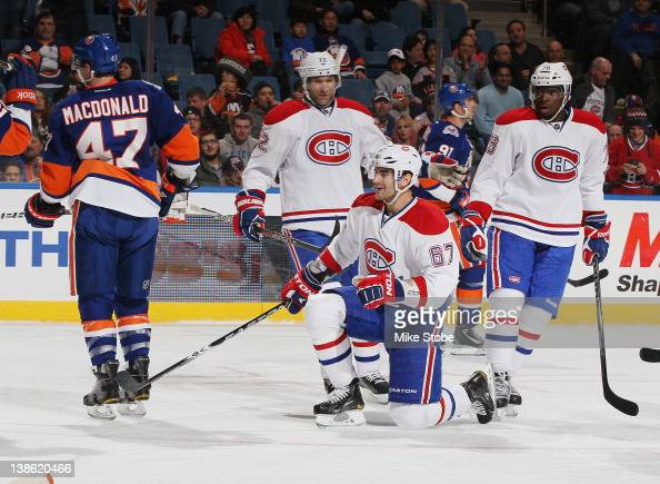 Max Pacioretty of the Montreal Canadiens celebrates his second goal of the game with teammates Erik Cole and PK Subban as Andrew MacDonald of the New...