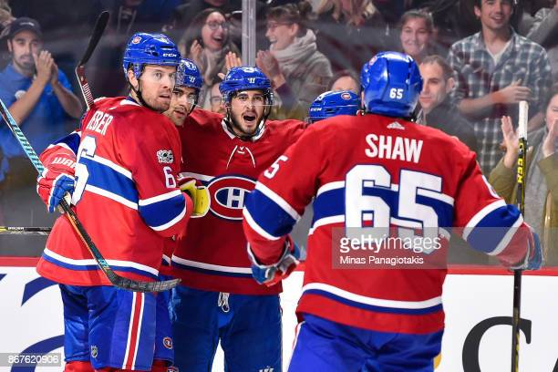 Max Pacioretty of the Montreal Canadiens celebrates his second period goal with teammates Shea Weber Phillip Danault and Andrew Shaw against the New...