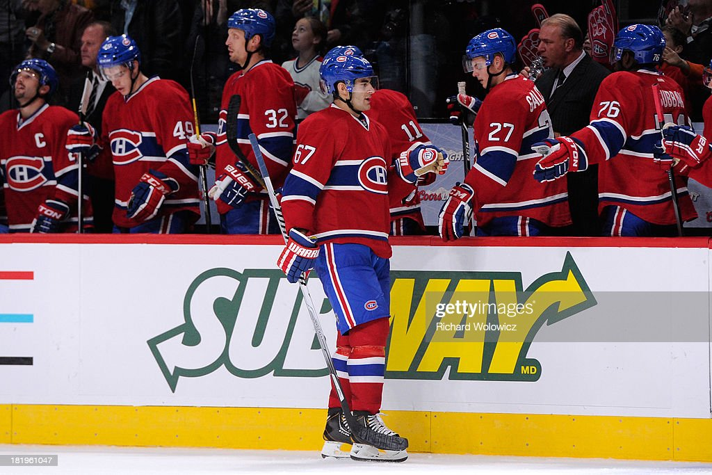 <a gi-track='captionPersonalityLinkClicked' href=/galleries/search?phrase=Max+Pacioretty&family=editorial&specificpeople=4324972 ng-click='$event.stopPropagation()'>Max Pacioretty</a> #67 of the Montreal Canadiens celebrates his third-period goal with teammates during an NHL preseason game against the Ottawa Senators at the Bell Centre on September 26, 2013 in Montreal, Quebec, Canada. The Canadiens defeated the Senators 3-1.