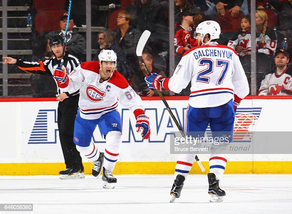 Max Pacioretty of the Montreal Canadiens celebrates the game winning power play goal by Alex Galchenyuk at 254 of overtrime against the New Jersey...