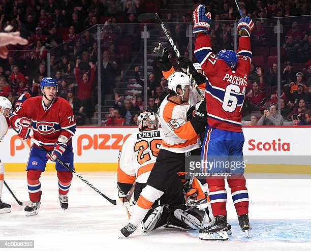 Max Pacioretty of the Montreal Canadiens celebrates the goal scored by PierreAlexandre Parenteau against the Philadelphia Flyers in the NHL game at...