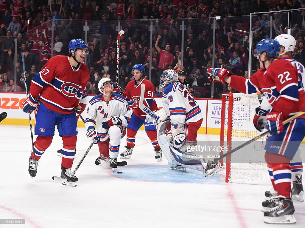 Max Pacioretty of the Montreal Canadiens celebrates with Dale Weise after scoring a goal against of the New York Rangers in the NHL game at the Bell...