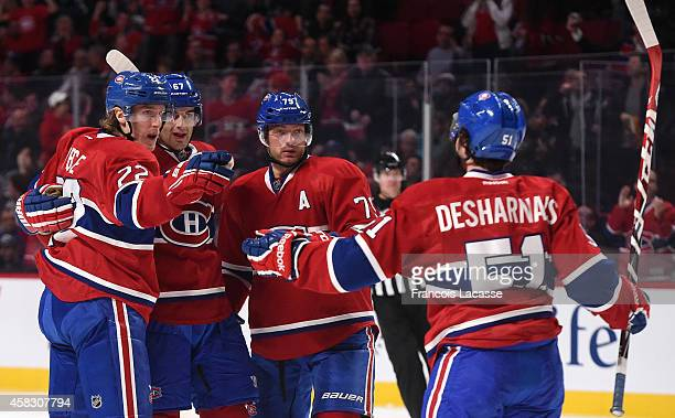 Max Pacioretty of the Montreal Canadiens celebrates with tea mates after scoring a goal against the Calgary Flames in the NHL game at the Bell Centre...