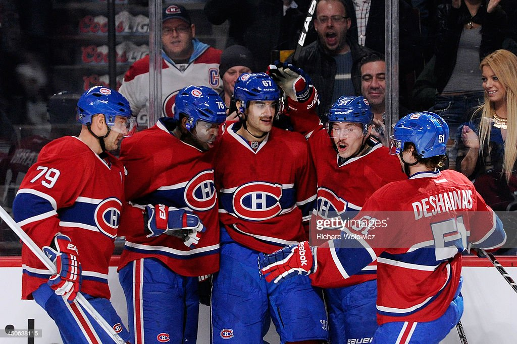 Max Pacioretty #67 of the Montreal Canadiens celebrates with teammates the second goal of his hat trick during the game against the Minnesota Wild goals during the NHL game at the Bell Centre on November 19, 2013 in Montreal, Quebec, Canada