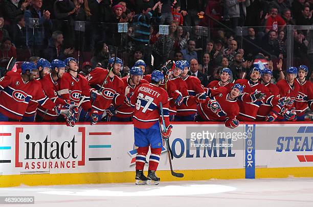 Max Pacioretty of the Montreal Canadiens celebrates with the bench after scoring a shoutout goal against the Florida Panthers in the NHL game at the...