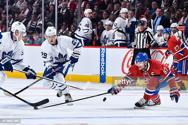 Max Pacioretty of the Montreal Canadiens defends the puck against William Nylander of the Toronto Maple Leafs during the NHL game at the Bell Centre...