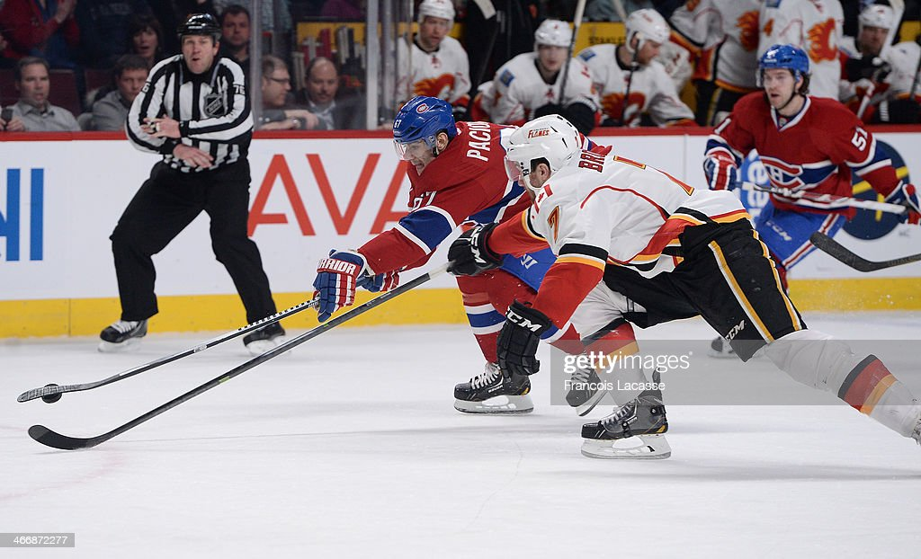 <a gi-track='captionPersonalityLinkClicked' href=/galleries/search?phrase=Max+Pacioretty&family=editorial&specificpeople=4324972 ng-click='$event.stopPropagation()'>Max Pacioretty</a> #67 of the Montreal Canadiens fights for the puck against <a gi-track='captionPersonalityLinkClicked' href=/galleries/search?phrase=TJ+Brodie&family=editorial&specificpeople=7220398 ng-click='$event.stopPropagation()'>TJ Brodie</a> #7 of the Calgary Flames during the NHL game on February 4, 2014 at the Bell Centre in Montreal, Quebec, Canada.