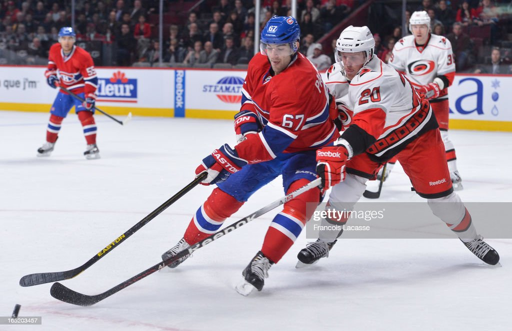 <a gi-track='captionPersonalityLinkClicked' href=/galleries/search?phrase=Max+Pacioretty&family=editorial&specificpeople=4324972 ng-click='$event.stopPropagation()'>Max Pacioretty</a> #67 of the Montreal Canadiens guards the puck from Riley Nash #20 of the Carolina Hurricanes during the NHL game on April 1, 2013 at the Bell Centre in Montreal, Quebec, Canada.