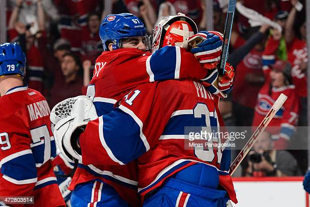 Max Pacioretty of the Montreal Canadiens hugs goaltender Carey Price after defeating the Tampa Bay Lightning in Game Five of the Eastern Conference...