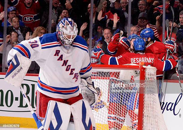 Max Pacioretty of the Montreal Canadiens is mobbed by his teammates after scoring a second period goal at 344 as Henrik Lundqvist of the New York...