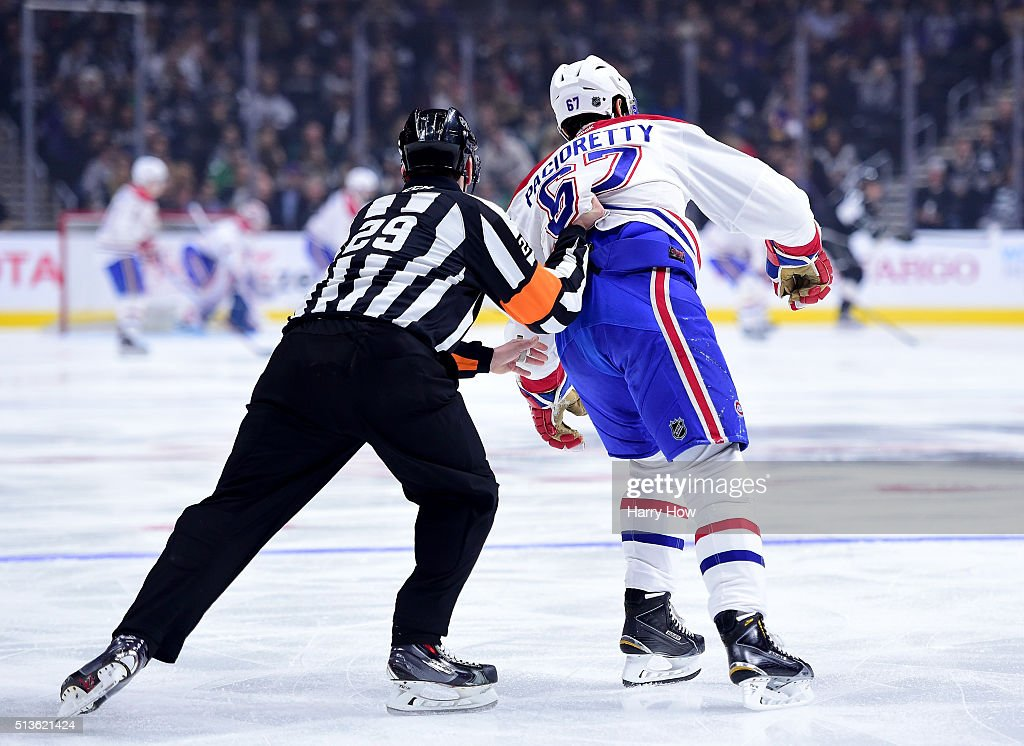 <a gi-track='captionPersonalityLinkClicked' href=/galleries/search?phrase=Max+Pacioretty&family=editorial&specificpeople=4324972 ng-click='$event.stopPropagation()'>Max Pacioretty</a> #67 of the Montreal Canadiens is pushed by referee Ian Walsh #29 to the bench after losing a blade during the first peroid at Staples Center on March 3, 2016 in Los Angeles, California. Anze Kopitar #11 of the Los Angeles Kings would score on the play at the other end.