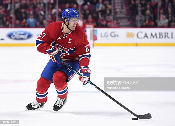 Max Pacioretty of the Montreal Canadiens looks to pass the puck against the New Jersey Devils in the NHL game at the Bell Centre on November 28 2015...