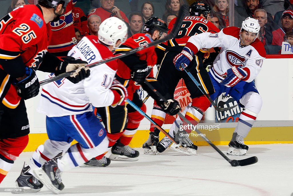 Max Pacioretty #67 of the Montreal Canadiens looks to poke check the puck from Matt Stajan #18 of the Calgary Flames at Scotiabank Saddledome on October 28, 2014 in Calgary, Alberta, Canada.