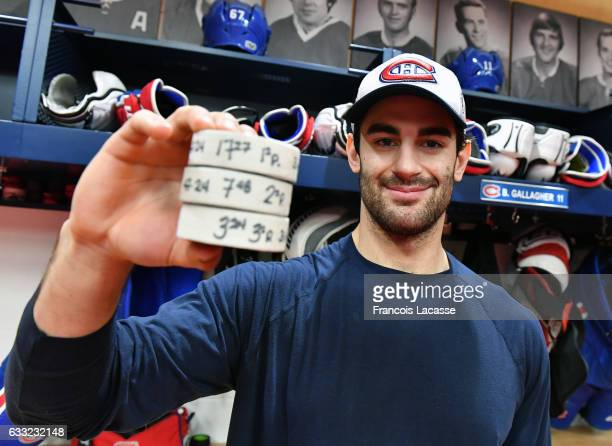 Max Pacioretty of the Montreal Canadiens poses with the pucks from his three goal against the Buffalo Sabres in the NHL game at the Bell Centre on...