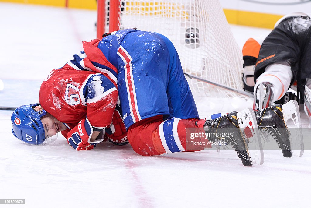 <a gi-track='captionPersonalityLinkClicked' href=/galleries/search?phrase=Max+Pacioretty&family=editorial&specificpeople=4324972 ng-click='$event.stopPropagation()'>Max Pacioretty</a> #67 of the Montreal Canadiens reacts after being taken down by Kimmo Timonen #44 of the Philadelphia Flyers during the NHL game at the Bell Centre on February 16, 2013 in Montreal, Quebec, Canada. The Canadiens defeated the Flyers 4-1.