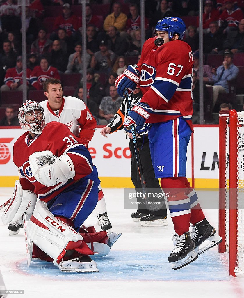 <a gi-track='captionPersonalityLinkClicked' href=/galleries/search?phrase=Max+Pacioretty&family=editorial&specificpeople=4324972 ng-click='$event.stopPropagation()'>Max Pacioretty</a> #67 of the Montreal Canadiens receives a shot on his chest in front of the net against the Detroit Red Wings in the NHL game at the Bell Centre on October 21, 2014 in Montreal, Quebec, Canada.