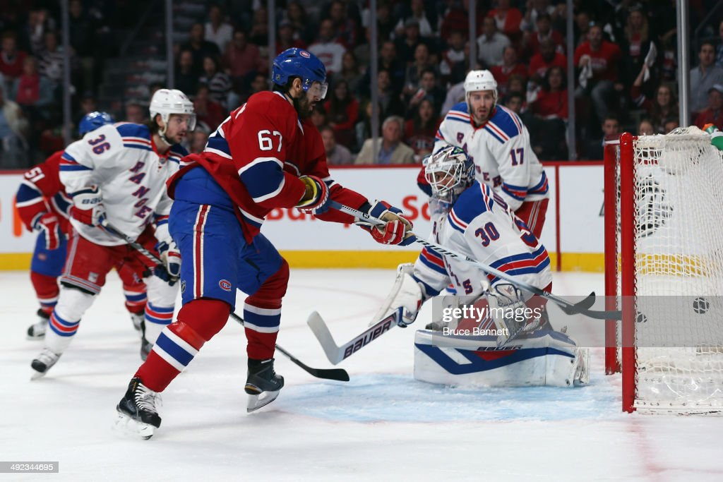 <a gi-track='captionPersonalityLinkClicked' href=/galleries/search?phrase=Max+Pacioretty&family=editorial&specificpeople=4324972 ng-click='$event.stopPropagation()'>Max Pacioretty</a> #67 of the Montreal Canadiens scores a goal against Henrik Lundqvist #30 of the New York Rangers during the first period in Game Two of the Eastern Conference Final during the 2014 Stanley Cup Playoffs at Bell Centre on May 19, 2014 in Montreal, Canada.
