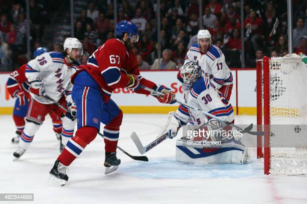 Max Pacioretty of the Montreal Canadiens scores a goal against Henrik Lundqvist of the New York Rangers during the first period in Game Two of the...